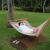 Veronica lounges on a hammock in front of the Outrigger Keauhou Bay